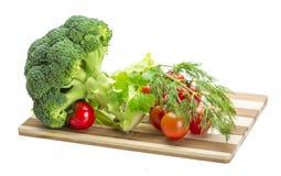 Brokoli e pomodoro ciliegia Fotografie Stock