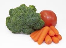 Brokuły, marchewki i pomidor, Fotografia Royalty Free