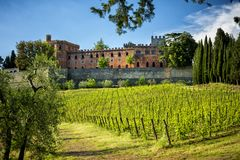 Brolio Castle and the nearby vineyards. The Castle is located in the production area of the famous Chianti Classico wine. Tuscany, stock photo