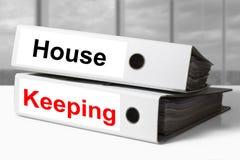 Büromappen-Haushalten Stockfoto