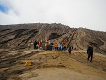 BROMO, INDONESIA - JULY 12, 2O17 : Tourists hiking up to the top of Mount Bromo, the active mount Bromo is one of the Stock Photography