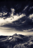 Bromo mountain under cloudy sky Stock Images