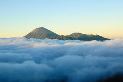 Bromo volcano. Mist are floating cover Mt.Bromo but still see Mt.Sumeru above stock image
