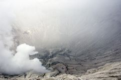 Bromo volcano crater. And plume of sulfur Stock Photos
