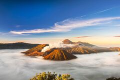 Free Bromo Volcano Crater Erupt Release Smoke With Sunrise Sky Background And Morning Fog Landscape At Indonesia Bromo National Park Royalty Free Stock Photos - 185633588