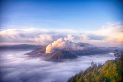 Bromo volcano spews a cloud of smoke. Bromo volcano vaporizes the smoke at dawn in Indonesia, Java Stock Image