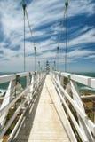 Bron som pekar Bonita Lighthouse utanför San Francisco, Kalifornien står på slutet av en härlig upphängningbro Arkivfoto