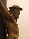 Bronce Christus op het Kruis Stock Foto