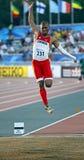 Bronce de Canadá Stewart de los hombres del salto de longitud Foto de archivo