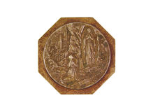 Bronce medal showing Our Lady of Lourdes isolated Royalty Free Stock Images