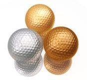 Bronce, plata, pelotas de golf del oro Imagen de archivo libre de regalías