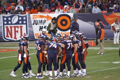 Bronco's huddle. Afc west champion denver bronco's against kansas city chiefs. Bronco's huddle up late in fourth quarter. bronco, s playing in the playoffs with royalty free stock photography
