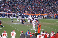 Bronco's offense. Afc west champion denver bronco's against kansas city chiefs. Tim Tebow running up the middle with two chiefs players preparing for the big hit stock image