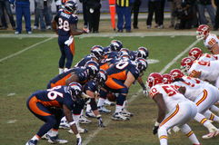Bronco's ready. Afc west champion denver bronco's offense lines up against kansas city chiefs. bronco, s playing in the playoffs with Tim Tebow. notice ball in stock photography