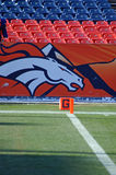 Broncos Goal Line. Close up shot of goal line and end zone pylon with a large bronco as a back drop royalty free stock images