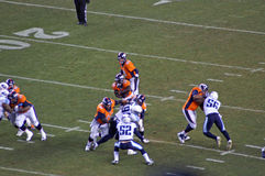 Broncos Lance Ball. Peyton manning hands off ball to lance Ball in victory over the titans stock photos