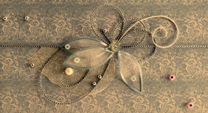Brons horisontalhandgjord hälsninggarnering med skinande pärlor Royaltyfri Fotografi