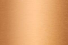Brons of koper geborstelde metaaltextuur royalty-vrije stock afbeeldingen
