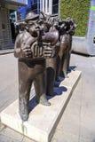 Bronsbeeldhouwwerk van gestileerde musici Stock Afbeeldingen
