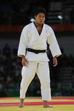 Bronsmedaillewinnaar Judoka Ryunosuke Haga van Japan in wit in actie tegen Jevgenijs Borodavko van Letland tijdens mensen -100 kg Stock Foto's