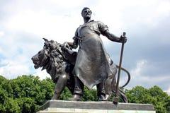 Bronsstaty av arbetaren med lejonet, Victoria Memorial, London Fotografering för Bildbyråer