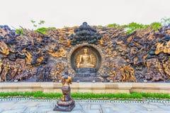 Bronsstatyer av den buddistiska berättelsen Arkivbild