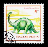 Brontosaurus, Dinosaurs serie, circa 1990. MOSCOW, RUSSIA - NOVEMBER 24, 2017: A stamp printed in Hungary shows Brontosaurus, Dinosaurs serie, circa 1990 Stock Photos