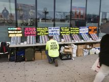 Man setting up table with Christian pamphlets to hand out in the Stock Images