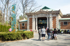 Bronx Zoo. BRONX, NEW YORK - APRIL 14, 2014: View of Bronx Zoo with visitors entering the Madagascar exhibit stock images