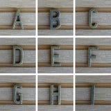 Bronz abecadła list na drewnianym tle A, b, C, d, E, F, G, Zdjęcie Royalty Free