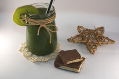 Bronz star, chocolate and green smoothie on a white background Royalty Free Stock Image