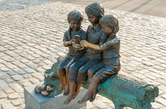 Bronz statue of three children with a turtle Royalty Free Stock Images