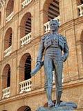 Bronz toreador statue. Bronz toreador and the spanish corrida behing Royalty Free Stock Images