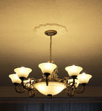 Bronze 8-lamp chandelier view from side Royalty Free Stock Photography