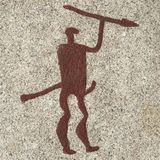 Bronze age man carving Royalty Free Stock Images