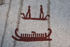 Bronze age rock carvings in Tanum ships. Bronze age rock carvings in Tanum, UNESCO world heritage site in Sweden Royalty Free Stock Photos