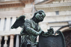 Bronze angel with the coat of arms Stock Image