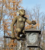 Bronze animal monkey statue. Garden decorations. Bronze monkey statue at the zoo with lantern. Closeup Stock Image