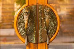 Bronze antique door handles in the shape of a lions head,closeup, concept of authentic objects royalty free stock image