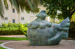 Bronze art sculpture Chicken Hen. Holon, Israel-July 21, 2016:  Bronze art sculpture Chicken Hen by Yael Artsi is installed under green trees in small city park Royalty Free Stock Photo