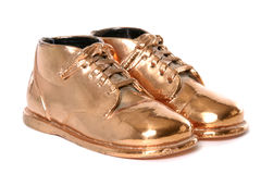 Bronze Baby Shoes. Pair of bronzed baby shoes royalty free stock images