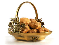 Bronze basket with pastry Stock Images