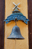 Bronze bell with wood wall welcome customer. Bronze bell with wood wall orange welcome customer Stock Photo