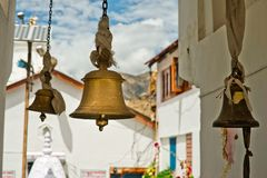 Bronze bells in front of Buddhist Temple. India Stock Photos