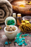 Bronze bowl with water and accessories spa. Sea salt and accessories for a rejuvenating spa sessions Royalty Free Stock Photos