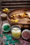 Bronze bowl with water and accessories spa treatments. Sea salt and accessories for a rejuvenating Spa sessions Stock Image