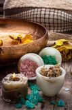 Bronze bowl with water and accessories spa treatments Royalty Free Stock Photography