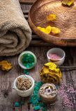 Bronze bowl with water and accessories spa treatments. Sea salt and accessories for a rejuvenating Spa sessions Stock Photos