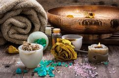 Bronze bowl with water and accessories spa treatments. Sea salt and accessories for a rejuvenating Spa sessions Royalty Free Stock Photos