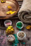 Bronze bowl with water and accessories spa treatments. Sea salt and accessories for a rejuvenating Spa sessions Royalty Free Stock Photo